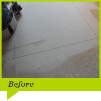 A limestone floor before cleaning