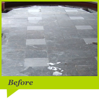 A marble floor before cleaning